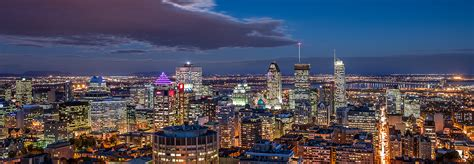 Aerial view of the Montreal skyline at night   CGE-EMB